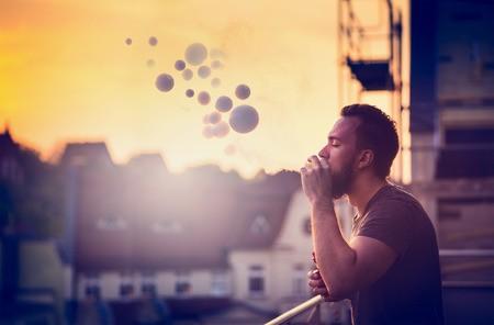 Vape Smoker on Balcony